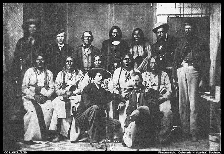 Camp Weld Council, September 28th, 1864. Standing L-R: Unidentified, Dexter Colley (son of Agent Samuel Colley), John S. Smith, Heap of Buffalo, Bosse, Sheriff Amos Steck, Unidentified soldier. Seated L-R: White Antelope, Neva, Black Kettle, Bull Bear, Na-ta-Nee (Knock Knee). Kneeling L-R: Major Edward W. Wynkoop, Captain Silas Soule.