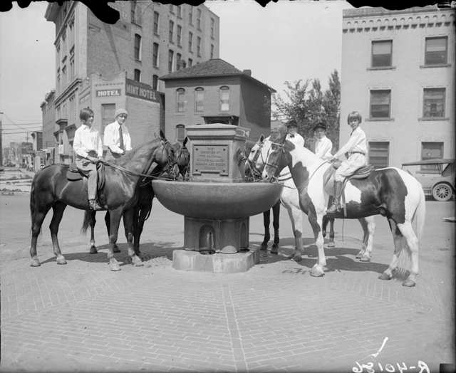 Humane Alliance watering fountain at the intersection of Colfax & Tremont photo by Harry M. Rhoads. 1920.